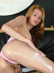 Saucy shemale loves stroking her think shecock with lotion