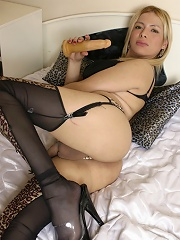 Blonde tranny stuffs tight ass with a rubber toy