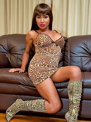 May shows her animal side in a leopard dress
